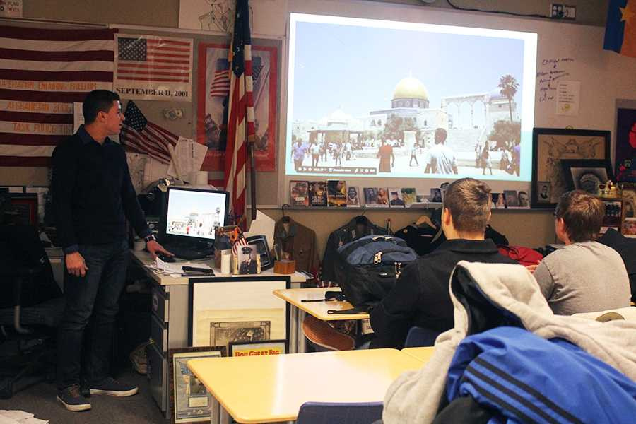 Jawad Nammari (11) shows a picture from his time in Palestine and Israel. Nammari signed up to show his presentation during History Club.