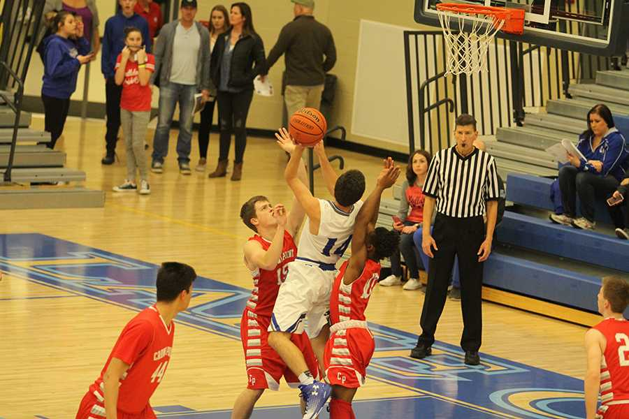 Zach+Dobos+%2810%29+goes+up+for+the+layup+and+gets+fouled.The+Indians+had+a+two+game+winning+streak.