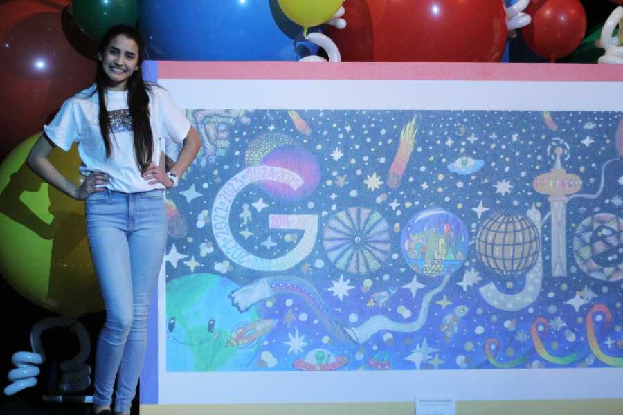 Veronica Gonzalez (9) poses with her Doodle for Google project. Gonzalez represented the state of Indiana in the contest.