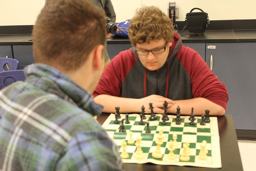 Members of the chess club play their game. The chess club meeting was held Thursday, March 2.