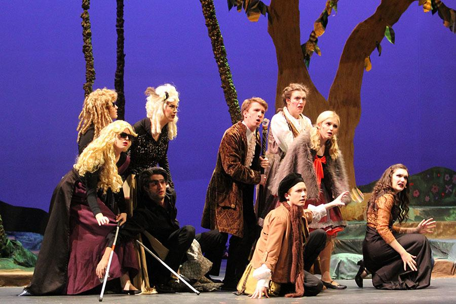 "Members of the ""Into the Woods"" cast show their confusion of what the giant is saying. They did not want the giant to kill them, so they had to listen to what the giant had to say."