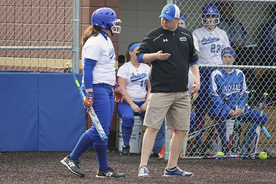 Coach Jeffrey Sherman coaches his team from the third base line. Sherman started coaching Lake Central softball in 2009.  Photo by: Nicole Reitz