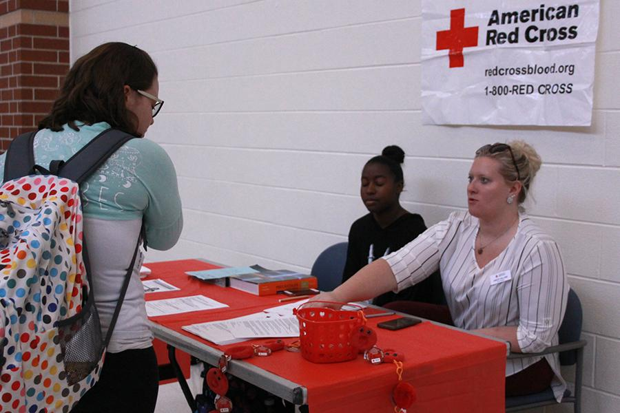 Alexys Watkins (12) assists in giving information for a student planning to give blood.  The blood drive will be held on Friday, April 21 between 7:30 AM and 1:00 PM.
