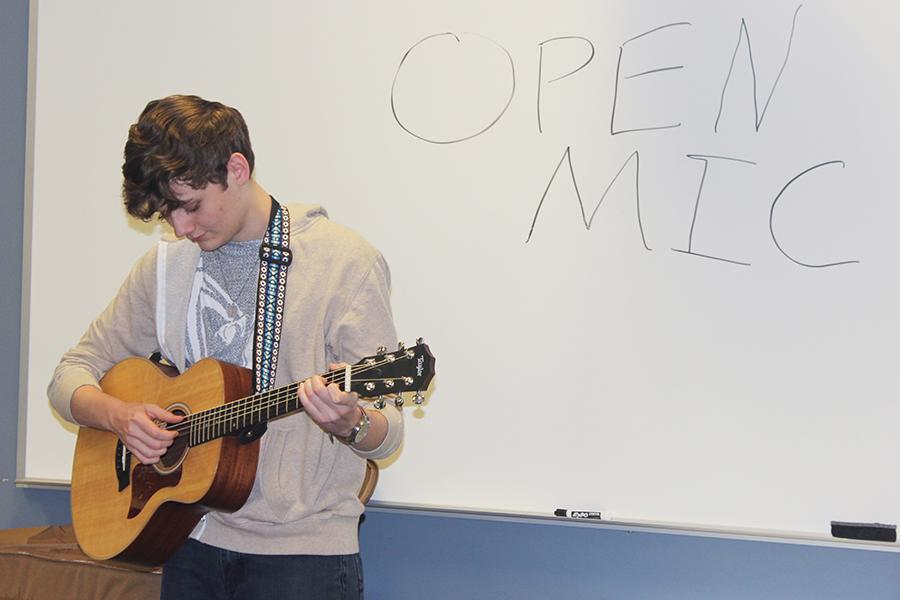 Mason+Crawford+%2811%29+starts+off+the+club+by+breaking+the+ice+and+playing+a+song+on+his+guitar.+Crawford+ran+the+Open+Mic+club+this+year+on+Thursdays+after+school.%0A