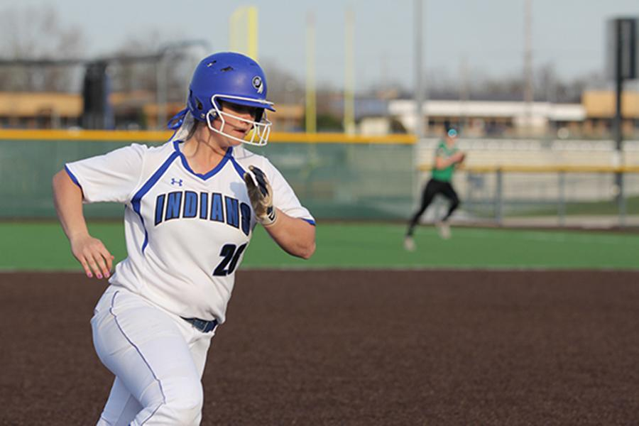 Alexandra+Hickey+%2812%29+rounds+third+base.+When+fielding%2C+she+played+in+the+infield.%0A