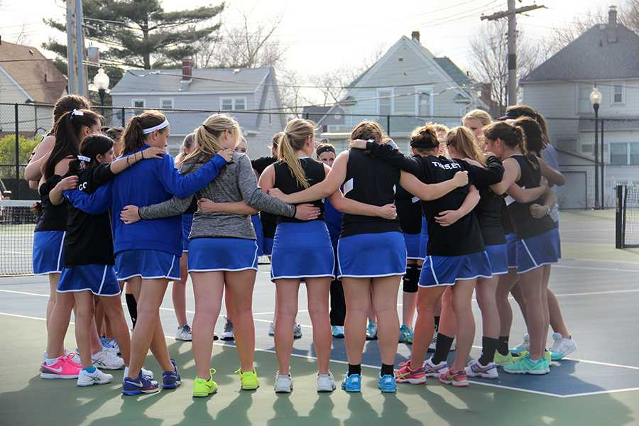 The girls tennis team huddles at their match at last season's' match. The girls finished last season 14-2. Photo by: Emma Degroot (12)