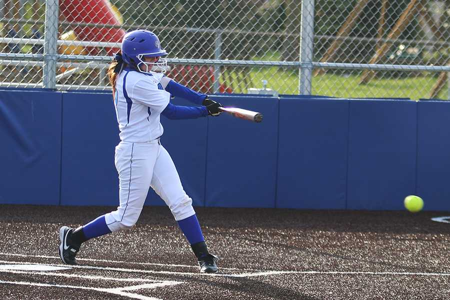 Madisen Tucker (11) hits the ball. Tucker had one hit out of her three at bats.