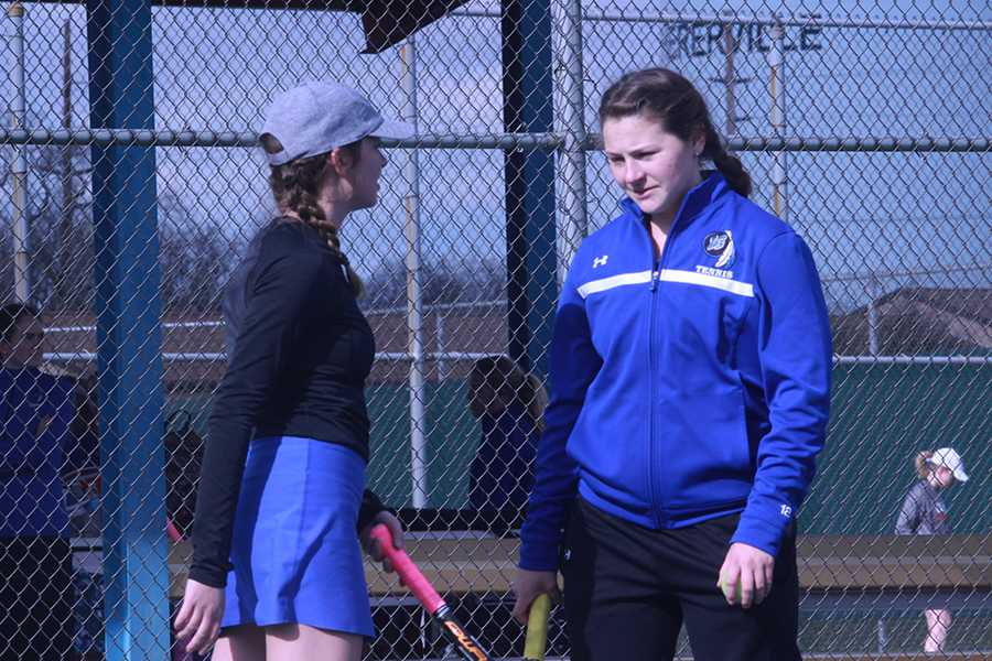 Lauren Gronek (12) and Anna Wachowski (12) joke with each other while practicing before the meet began. Gronek and Wachowski had a successful turnout for the match.