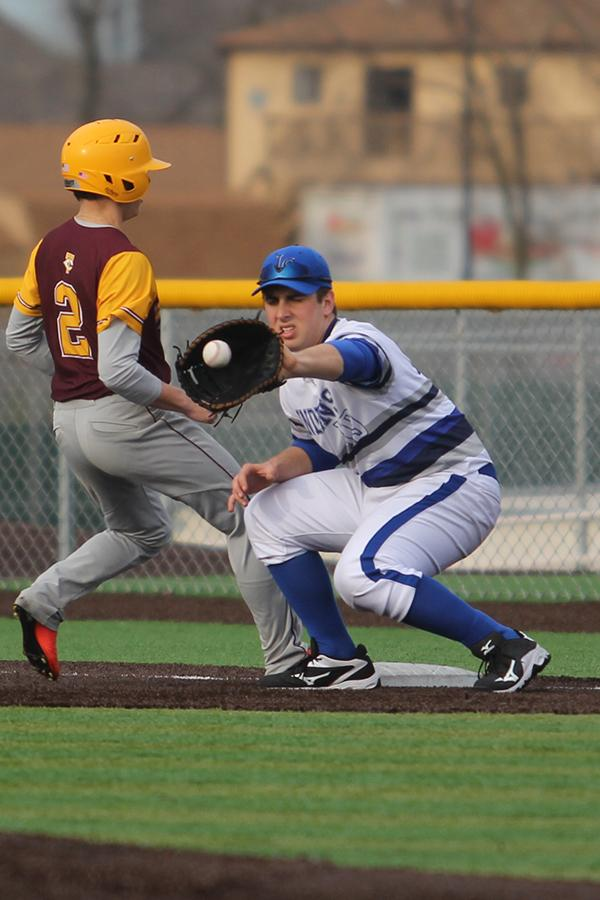 Chris Fundich (12) catches the ball at first base. There were 13 seniors on varsity.