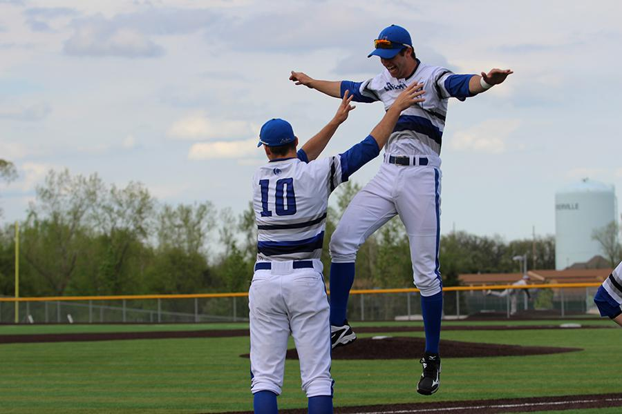Benjamin Nisle (12) and Nicholas Bandura (12) share some pre-game excitement. The team went on to defeat Merrillville 13-0 in the fifth inning.