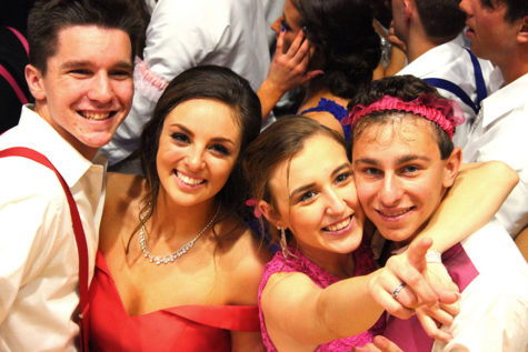 Daniel Picioski (12), Rylee Platusic (11), Molly Stokes (11) and Christopher Baranowski (12) grin at the cameras. Prom was the last dance of the school year.