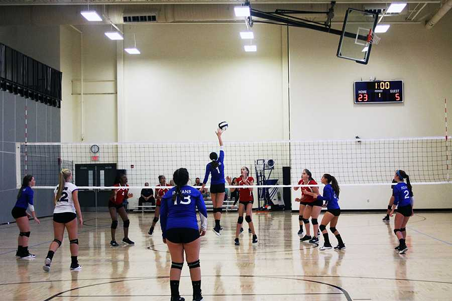 The freshman girls stand ready as they battle Portage. Katherine Mahoney (9) spiked the ball over the net into the hands of Portage players.