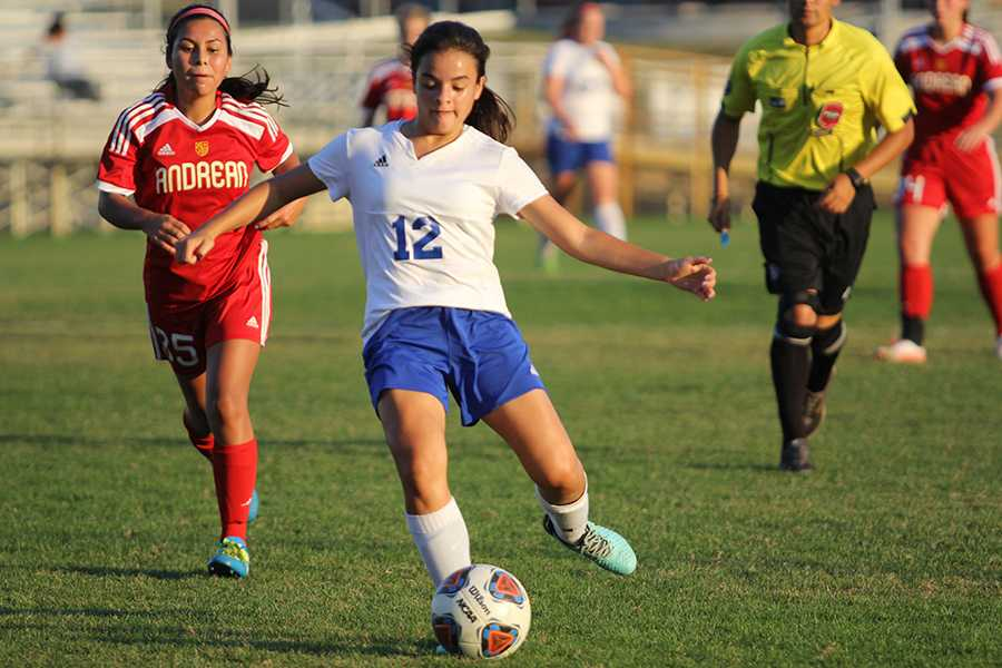 Veronica Ruiz-Avila (9) kicks the ball toward Andrean's goal. This is Ruiz-Avila's first year on JV.