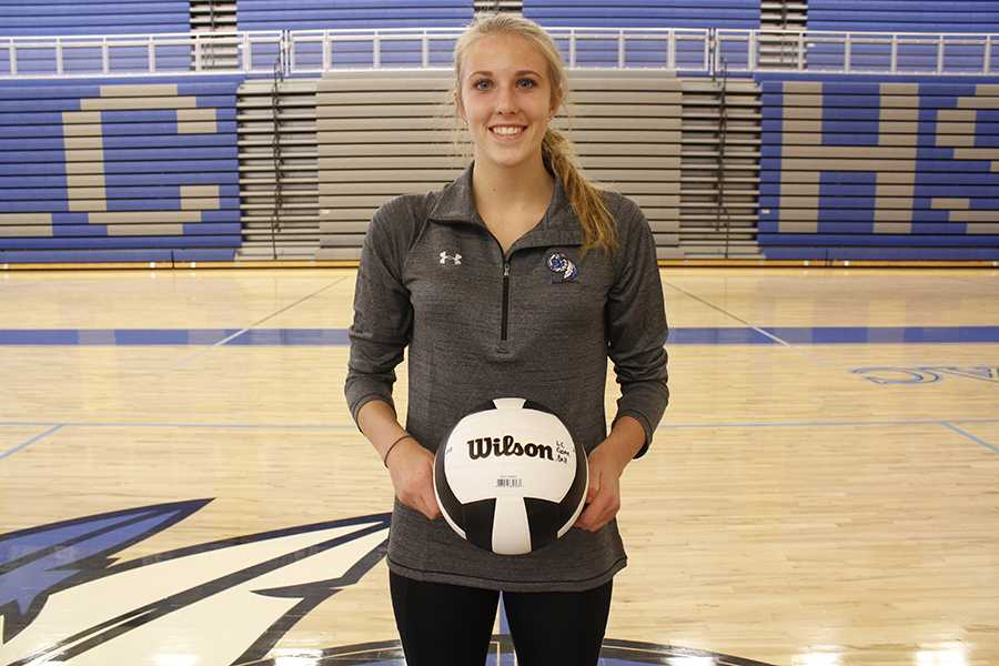 Amanda Robards (11) poses with a game ball. Robards has been on the Varsity volleyball team since her freshman year.