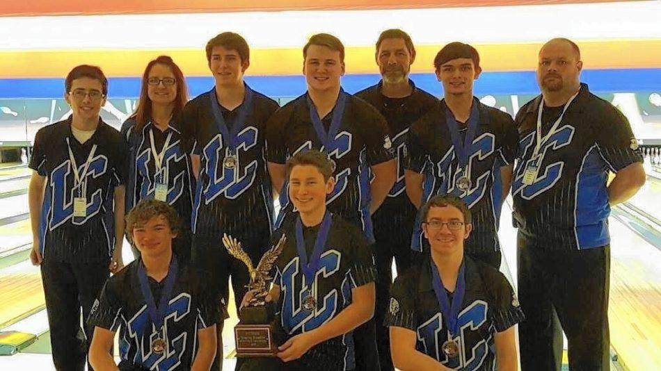 The Lake Central Boys Bowling team stands together for a picture taken by one of the parents. Lake Central won this tournament against multiple other high school bowling teams.