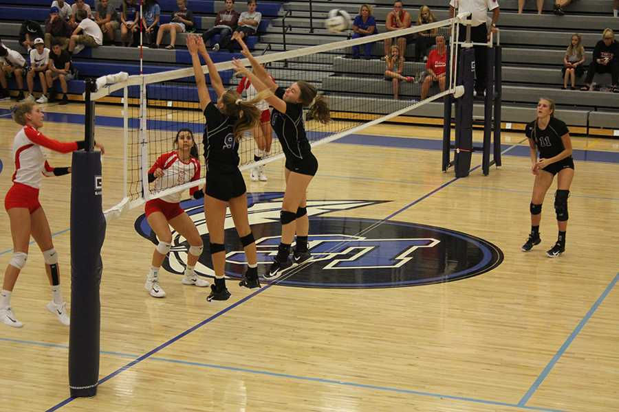 Talia+Gruthusen+%2811%29+and+Emma+Best+%289%29+block+a+ball+during+their+challenging+home+game+against+Crown+Point.+Their+next+home+game+will+be+Mon.+Sept.+25+against+Bishop+Noll.%0A%0A