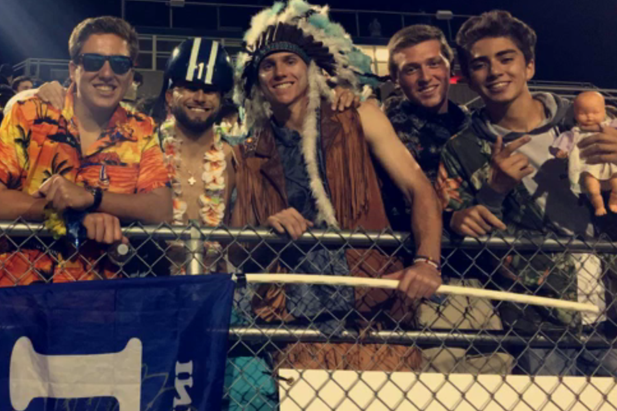 The+LC+Fan+Section+supports+the+Tribe+as+they+play+against+Portage+High+School.+The+theme+was+Hawaiian.+%0A
