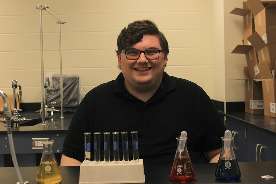 Mr. Daniel Fox, Science, poses with chemicals that were used in a Chemistry lab. Mr. Fox attended Valparaiso University and minored in Physics.