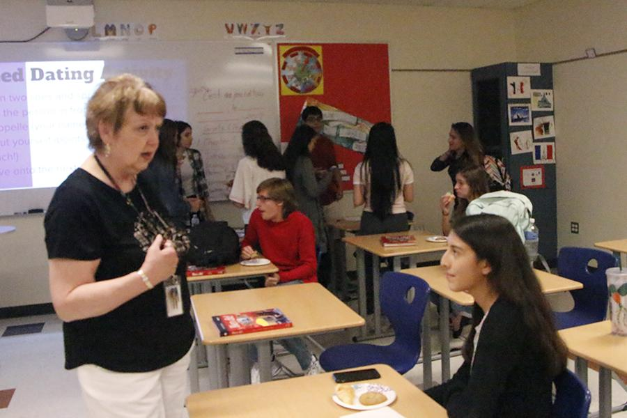 Ms.+Bovard+talks+with+a+student+about+different+French+foods+and+treats.+Ms.+Bovard+had+been+sponsoring+French+club+for+the+last+two+years.%0A%0A
