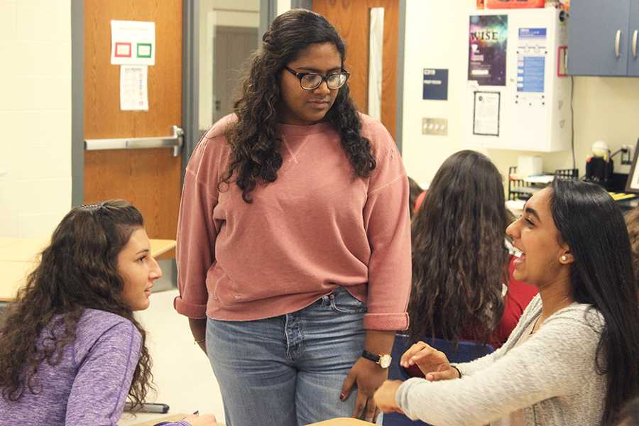 Gina Szymborski (12), Safia Mohiuddin (11) and Jaskiran Kaur (12) talk before the meeting starts. WISE was created for girls to explore STEM fields.