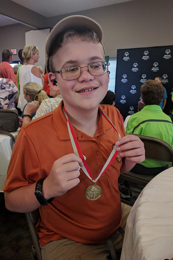 Conner Caffarini (9) competed in the Special Olympics. Caffarini (9) won a gold medal in golf.