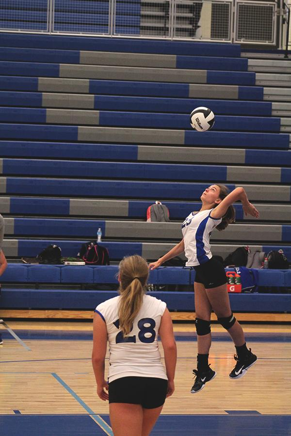 Josephine Mulligan (9) serving the ball to the other team. Milligan successfully served the ball scoring a point for LC.
