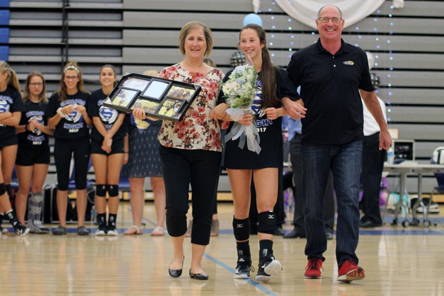 Mia+Dinino+%2812%29+walks+down+the+court+with+her+parents.+There+were+three+seniors+on+the+varsity+team+this+year.+%0D%0A