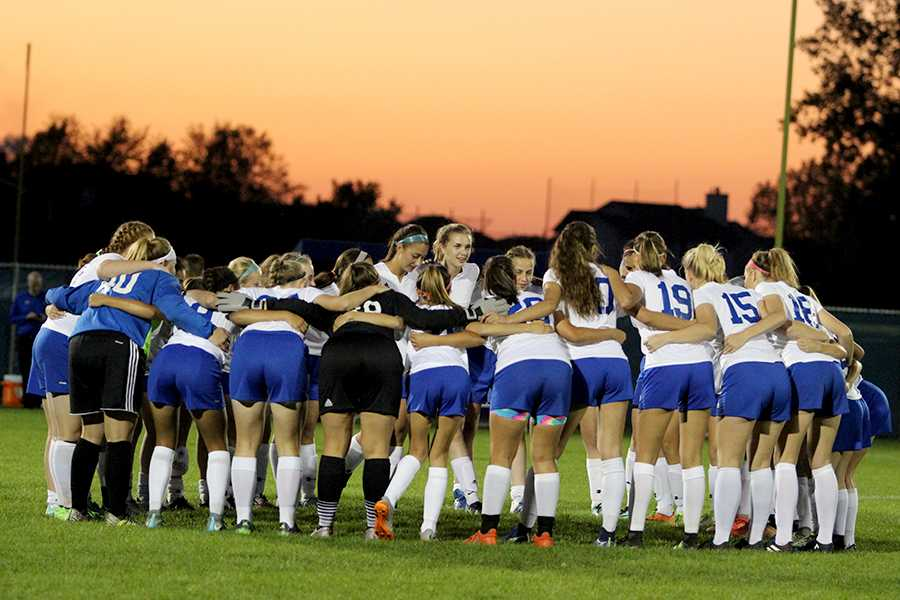 The Lady Indians gather around one final time on the LC field as a team. The team was very emotional prior to the game showing many tears as seniors walked down the field.