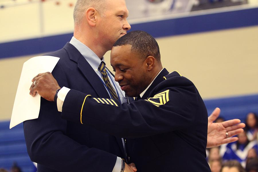 Principle Sean Begley welcomes Master Sergeant Alan Thomas Jr.  Thomas delivered the first guest speech of the ceremony.
