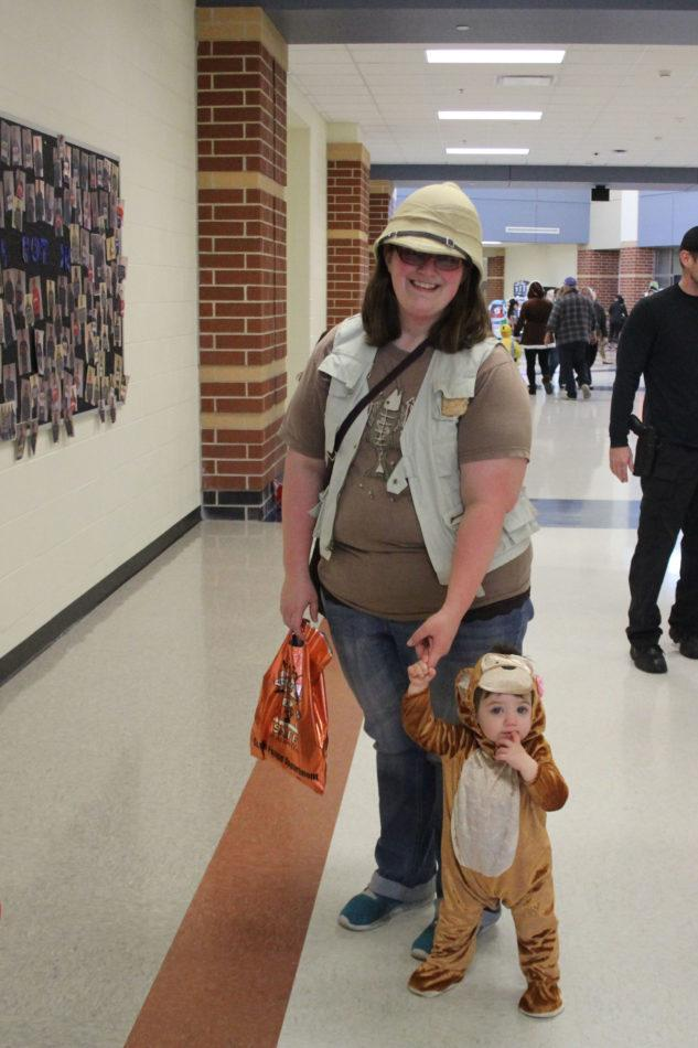 Mrs. Julie Shupryt, Science, and her son enjoy trick or treating. The two had been dressed up as a monkey and an explorer.