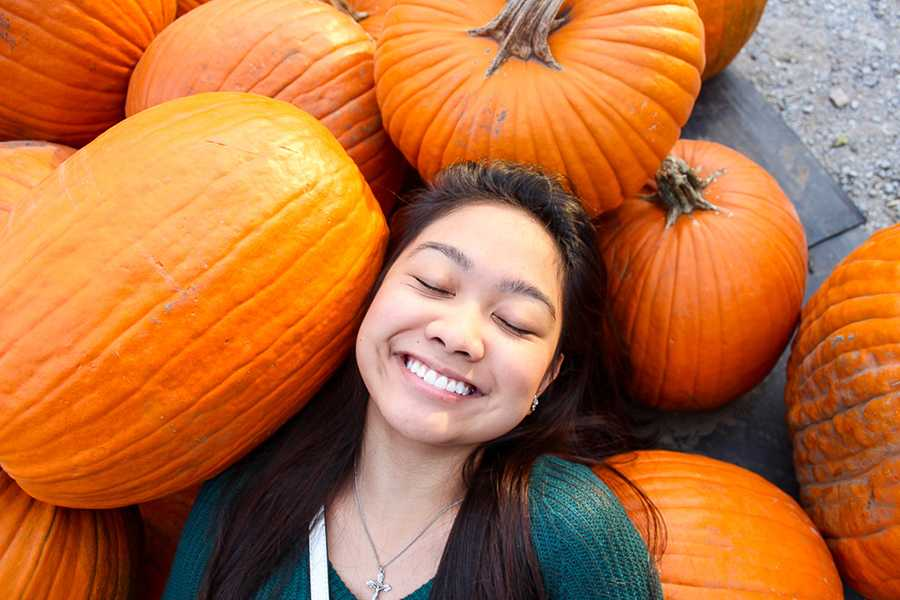+Rheena+Molina+%2812%29+smiles+as+she+lays+around+pumpkins.+She+went+to+Elzinga+Farm+Market+to+look+for+pumpkins+to+carve.++