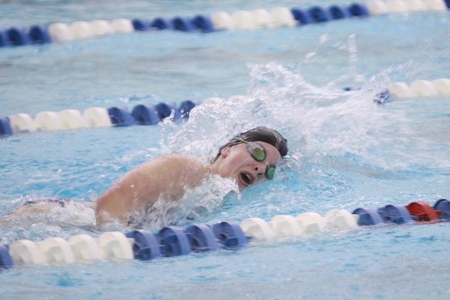 Hanna Spoolstra (9) swims the 500 yard freestyle. Spoolstra placed second out of seven girls and this is Spoolstra's first year on varsity.