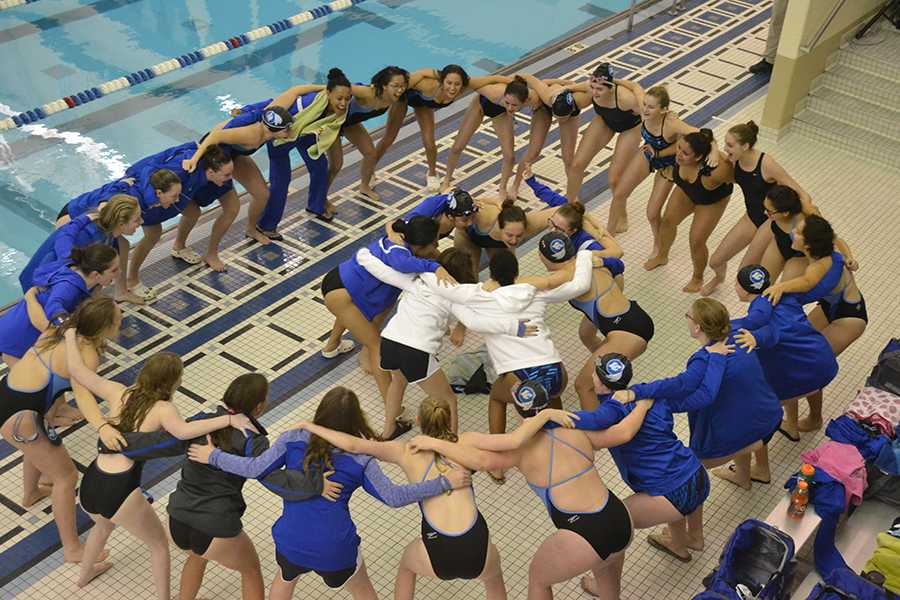 The girls huddle around each other to chant and excite one another. This was their first meet of the 2017- 2018 season.