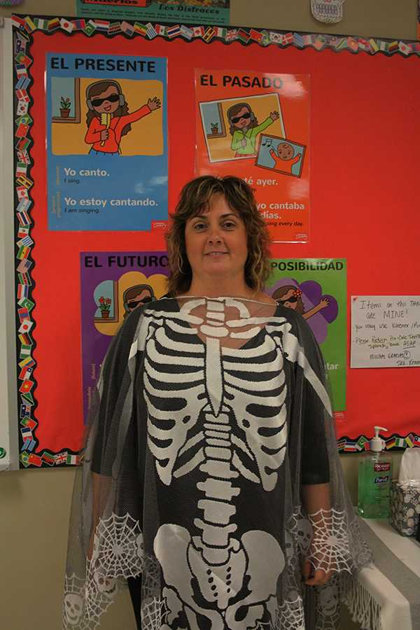 Mrs. Rosemary Kennedy, Foreign Language, celebrates Day of the Dead with her loved ones. She has dressed up every year to show her passion around this time of the year.