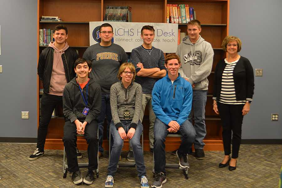 "The tech help team poses for a picture. After this picture, the team posed for a ""silly picture"", requested by Mrs. Schweitzer."