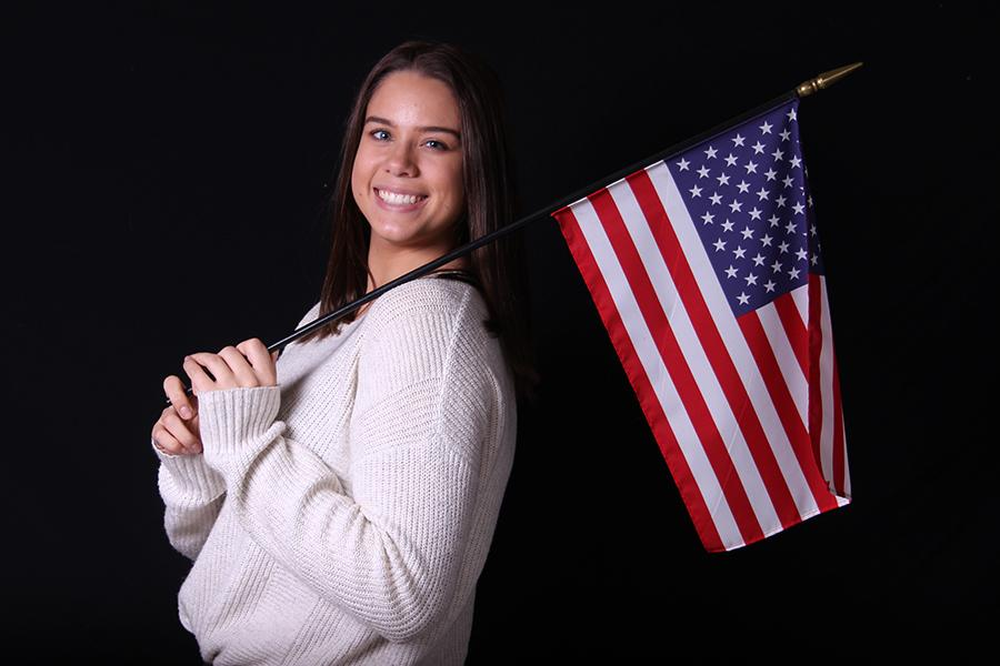 Paityn Emro (12) poses with an American Flag. Emro held it to represent her patriotism as she joins the Air Force.