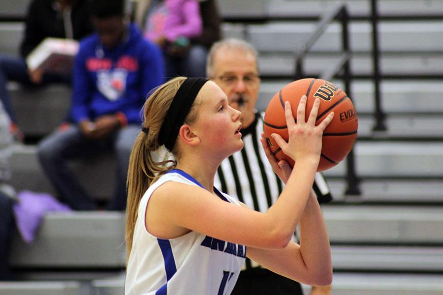 Makenna+Hullinger+%289%29+focuses+before+taking+a+free+throw.+Hullinger+was+able+to+make+the+shot.%0A