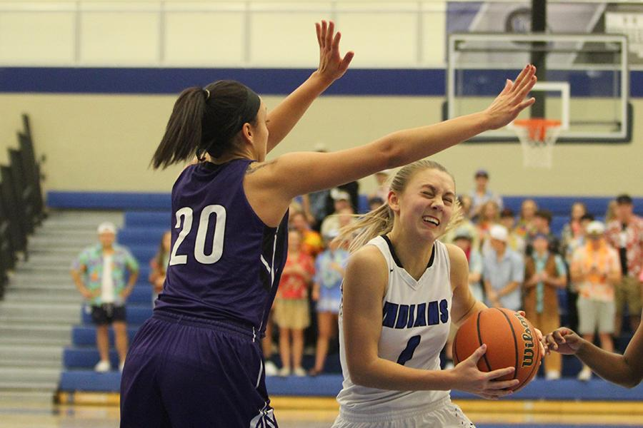 Lauren Ladowski (12) makes a last minute effort to score. Lake Central beat Merrillville 51-28.