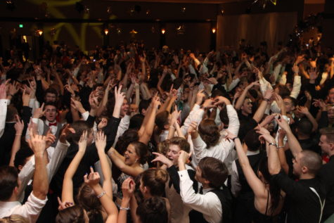 Students raise their hands during the Winter Formal dance. The formal dance for the 2017-2018 school year was Jan. 20. Photo by Justin Andrews