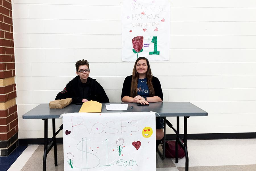 Julie Popiela (12) (left) and Rachel Miotke (12) (right) sell roses for Interact Club. The proceeds from the roses sold were to support Autism Awareness.