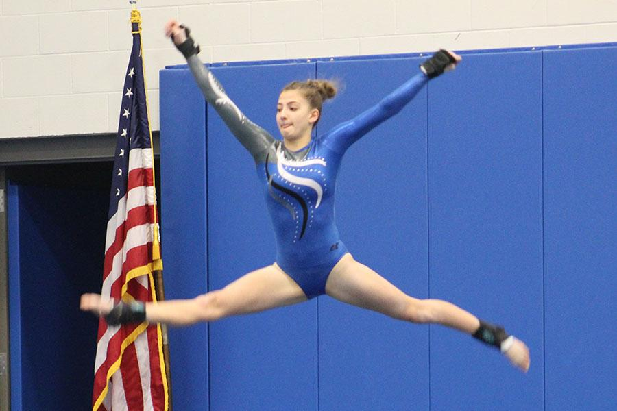 Gabrielle Devries (11) jumps during her floor routine. The girls competed on Feb. 6.