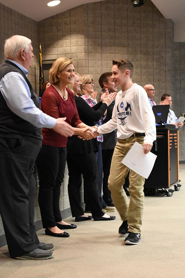 Mitch+Milausnic+%288%29+shakes+hands+with+board+member+Mrs.+Janice+Malchow.+Kahler+Middle+School%E2%80%99s+basketball+team+was+honored+at+the+meeting.