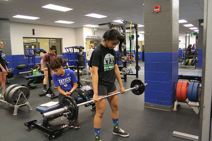 Kelani Benson (12) works out in the weight room preparing for the upcoming track meets. The team's first meet will be Wednesday, Feb. 21.