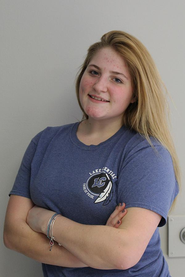 Emily Mosher (10) poses for a mugshot. She represented the Tribe of Pride by wearing her marching shirt.