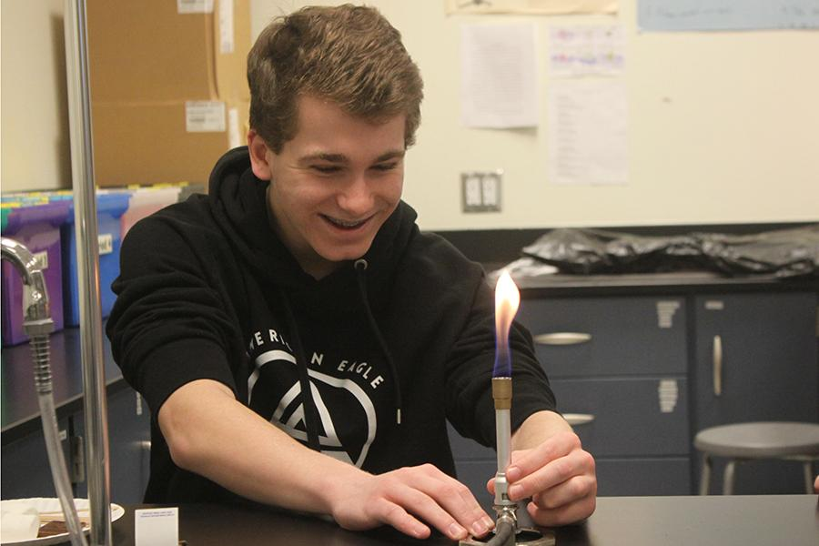 Allen+Kostecki+%2810%29+smiles+after+lighting+the+bunsen+burner.+Kostecki+was+then+able+to+roast+marshmallows+for+his+lab.+