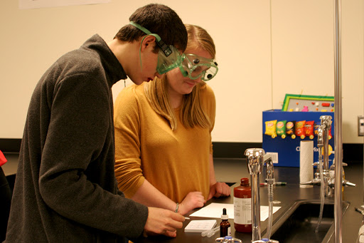 Ian Butler (10), along with partner Adriana Klein (10), prepare for their lab by reading the direction. They analyzed the problem and began setting up their experiment.