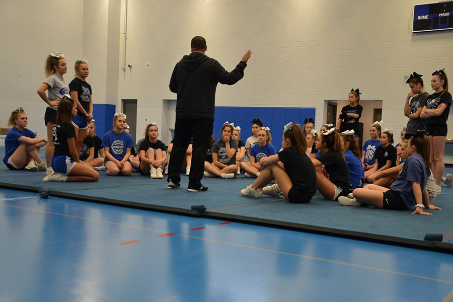 Coach+John+Powers+announces+what+will+take+place+during+tryouts.+The+girls+listened+intently+for+what+to+expect+during+the+next+three+hours.+