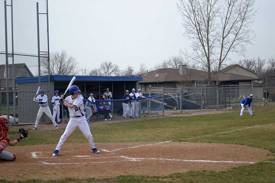 Dylan+Moffit+%2810%29+stands+readily+at+the+plate.+He+hit+a+single+and+caused+a+run+to+be+scored.+%0A