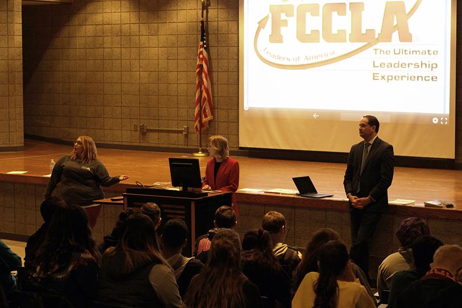 The two guest speakers pull up their presentation. Wagoner started the presentation by explaining to the students what FCCLA does.
