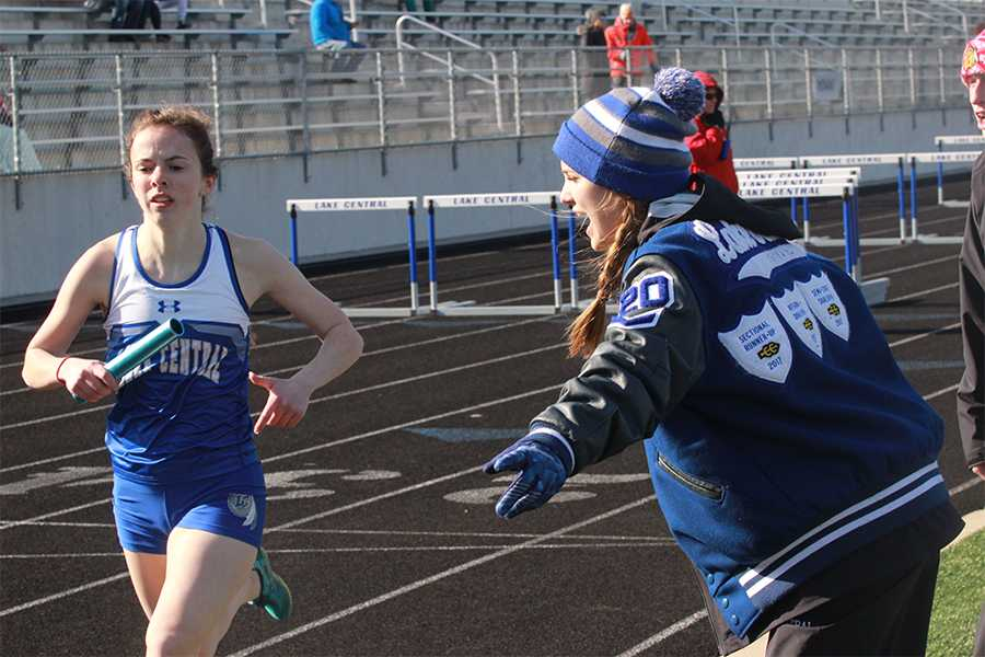 A+teammate+encourages+Samantha+Dittrich+%2812%29+during+the+3200+meter+relay.+Lake+Central+placed+second+in+the+relay.